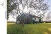 Wohnen auf einer Ebene: Bungalow mit schönem Gartengrundstück in Lage-Müssen - 003 - Rückansicht