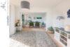 Wohnen auf einer Ebene: Bungalow mit schönem Gartengrundstück in Lage-Müssen - 007 - Wohnen und Essen - Ansicht 1