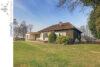 Wohnen auf einer Ebene: Bungalow mit schönem Gartengrundstück in Lage-Müssen - 001 - Gartenansicht