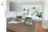 Wohnen auf einer Ebene: Bungalow mit schönem Gartengrundstück in Lage-Müssen - 009 - Wohnen und Essen - Ansicht 3